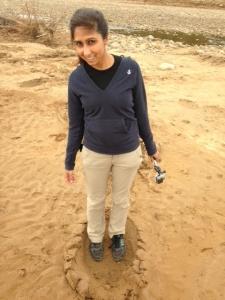 Noreen standing in an elephant footprint!